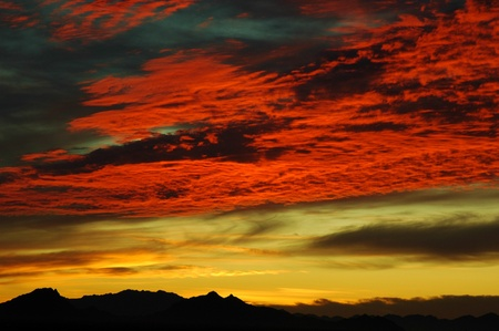 silhoutted: Intense sunset set with silhoutted mountains