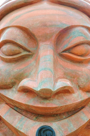 A native stone carving of a spiritual being