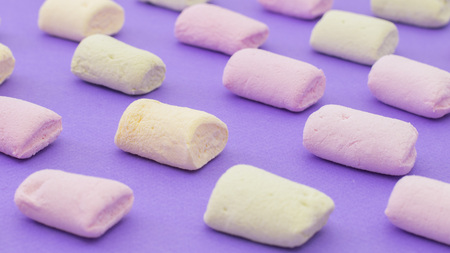 Pattern with pink green and yellow with marshmallows on violet background 版權商用圖片
