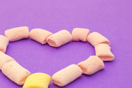 Love heart with pink and yellow marshmallows