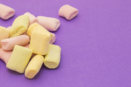 Pink and yellow with marshmallows on violet background 版權商用圖片