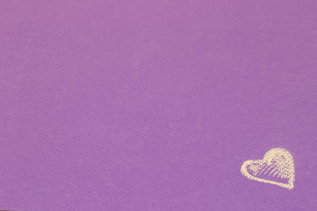 White heart painted with chalk on violet background Stock Photo