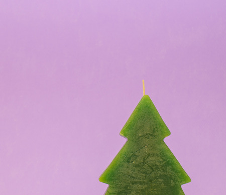 Christmas candle tree on violet background