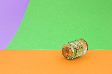 Little glass bottle on bright background