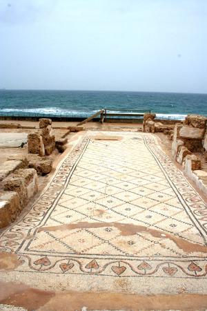 testaments: Ancient Mosaic floor at the ruins of Caesarea, Israel