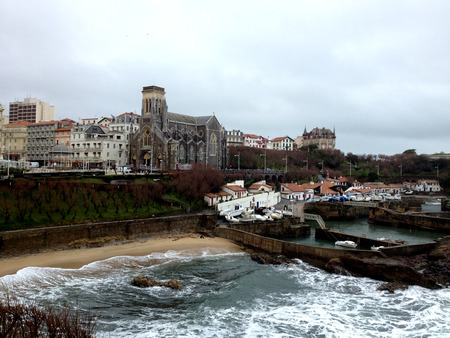 major ocean: ld harbour of Biarritz, France. View of the city of Biarritz and it Byzantine church, Gulf of Biscay, South West France Stock Photo