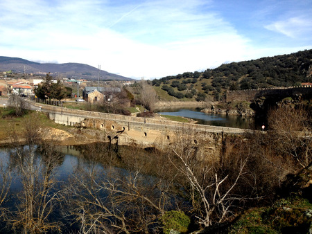 adulation: Buitrago del Lozoya is one of the few town in Spain that have maintained its walls, which are of Moorish origin 11th century and have been restored in the 15th century. It lies on a peninsula surrounded by the Lozoya river.