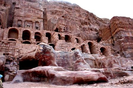 petra  jordan: Tombs carved into the red sandstone in Petra, Jordan. Ancient city, capital of the Nabataean kingdom - city of Petra in Jordan