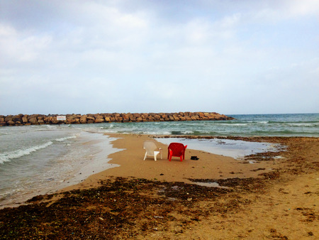 things that go together: Two lounge chairs overlooking the Mediterranean Sea.