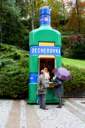 karlovy vary: Karlovy Vary, Czech Republic - October 12, 2011: Tourists in the queue to kiosk for becherovka in Karlovy Vary, Czech Republic. Beherovka is a herbal bitters that is produced in Karlovy Vary, Czech Republic. It is flavored with anise seed, cinnamon, and a