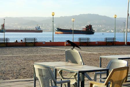 mid distance: Red Sea, Aqaba, Jordan. Urban beach in jordanian town Aqaba. Stock Photo