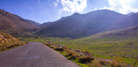 descends: Lebanese landscape and highway. A road from Bcharre descends toward the Bekaa Valley in northern Lebanon.