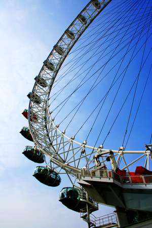 metres: The London Eye Ferris wheel close-up in London, UK. The entire structure is 135 metres tall and the wheel has a diameter of 120 metres.