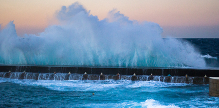 swell: Storm on the sea in Beirut, Lebanon. A large swell crashes against a dock in Beirut
