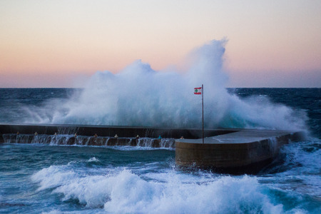 beirut lebanon: A large swell crashes against a dock in Beirut, Lebanon.
