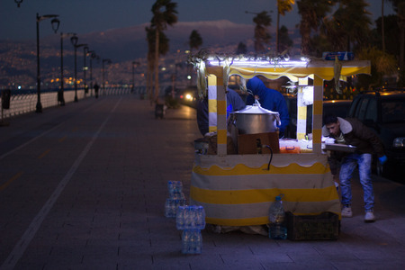 lebanon beach: Beirut, Lebanon - December 5, 2015: Street food point on famous cornice seaside in Beirut works 247 and cookers preparing some local snacks.