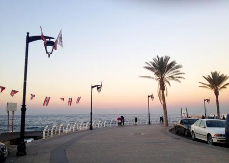 lebanon beach: The famous seaside Corniche on sunset, Beirut, Lebanon. Beirut, Lebanon - December 24, 2015: People take their sunset walk on the famous Corniche (seaside promenade) in Beirut, Lebanon Editorial