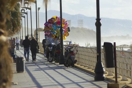 beirut: Beirut street view. Beirut, Lebanon - January 09, 2016: Balloons seller and pedestrians on Beirut seaside near Ramlet el-Baida beach, street view, Lebanon