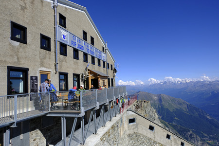 The rifugio can be reached by a modern cable car. It offers a beautiful view of Monte Bianco. Редакционное