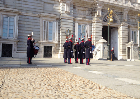 Changing of the Guard. The Royal Palace of Madrid is the official residence of the Spanish Royal Family, Madrid, Spain Editorial