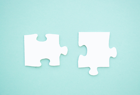 Two Puzzle Pieces On Blue Background As A Symbol Of Autism Awareness