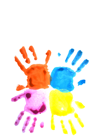 Four colorful child's handprints isolated on white with copyspace. World autism awareness day concept.