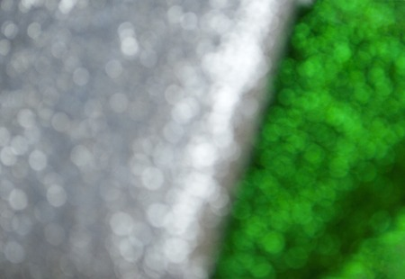 Silver and green glittery shimmering background with blinking details. Stock fotó