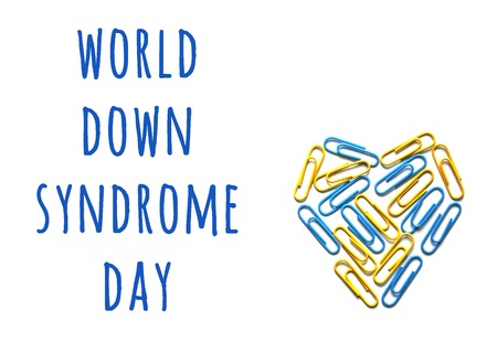 World down syndrome day. Down syndrome day concept with yellow and blue heart isolated on white background with copyspace. 版權商用圖片