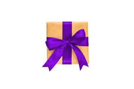 Giftbox tied with purple color ribbon isolated on white. Flat lay style. Stock Photo