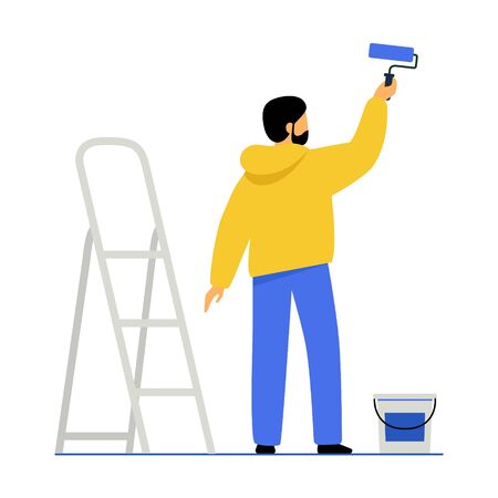 A man paints a wall with paint. The guy holds a paint roller in his hand, next to it is a stepladder and a can of paint. The male makes repairs in the room.
