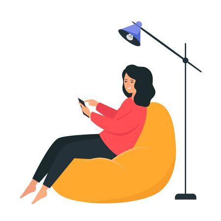 A girl sits on a bag chair and holds a smartphone in her hands. Happy young woman chatting on the internet. Interior illustration on a white background