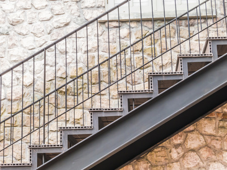 concrete steps: Stair metal and stone wall