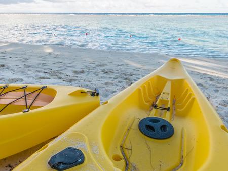 black white kayak: Yellow kayak on the tropical sandy beach Stock Photo