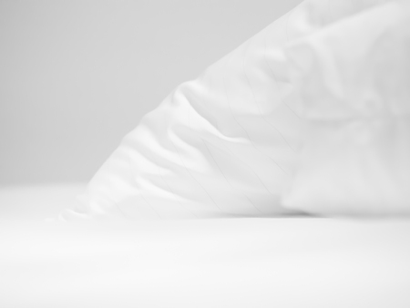 Closeup of white pillow on bed in bedroom. Imagens