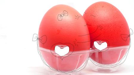 desayuno romantico: Abstract couple of eggs hugging and kissing. Creative and idea concept.