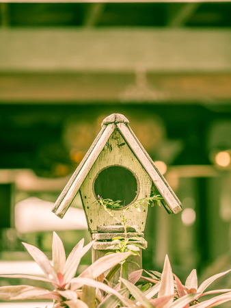 Vintage tone. Wooden birdhouse for bird s nest.