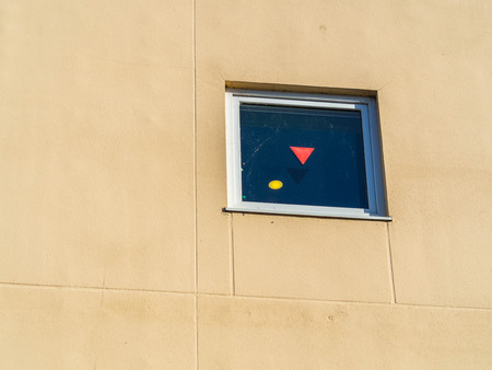 The red triangle on window indicates an access point for firefighters in case of emergency.