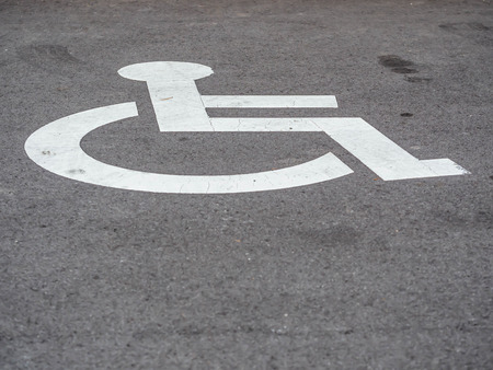 Disabled user car park space with wheelchair symbol.
