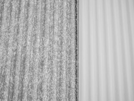 Abstract black and white tone background. Closeup of white and gray wave or vertical striped pattern, plastic wall texture. Reklamní fotografie
