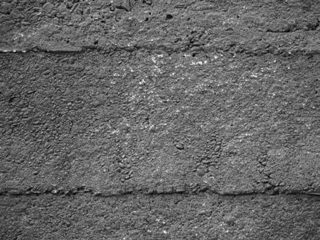 Abstract black and white background tone. Closeup of horizontal striped pattern of rough cement or concrete wall or floor texture.