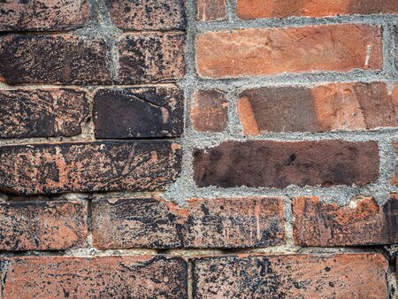 Abstract background and closeup of old and dirty brick tiles or grids pattern, rough cement or concrete texture.