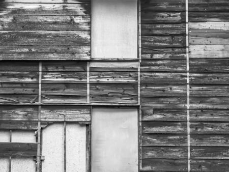 Abstract black and white background. Striped and grids pattern of old and dirty wooden and cement or concrete ancient house wall texture. Reklamní fotografie