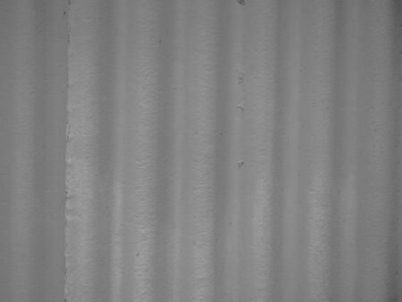 Abstract black and white tone background. Closeup of vertical wave pattern of concrete or cement wall texture.