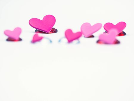 Closeup of vivid and vibrant pink and pastel pink hearts shape on gray color background. Valentine 's day, wedding ,love, sweet and romance concepts and ideas.