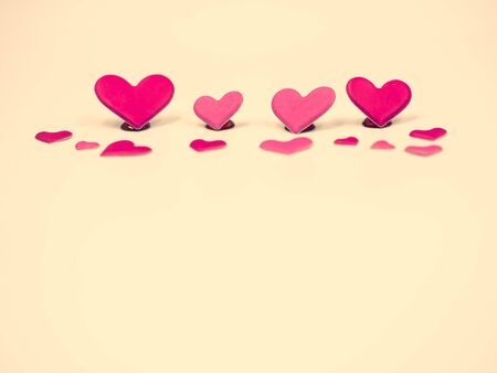 Crossed process tone of sweet and romance red and pink hearts shape on yellow pastel color background. Valentine 's day, wedding or love concepts and ideas.