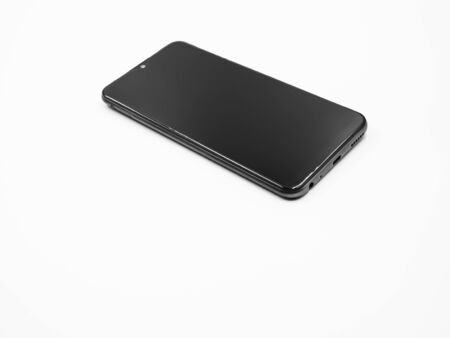 Black and white tone and closeup of smartphone on gray background.
