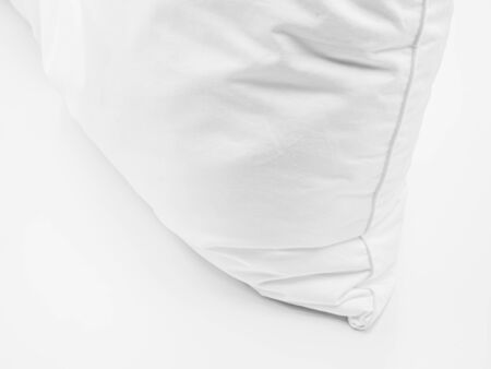 Closeup of white pillow on the bed in the bedroom. Imagens