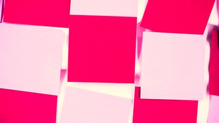 Abstract cross processed tone for vintage and retro background. Closeup of horizontal grids pattern of pink and red note paper texture.