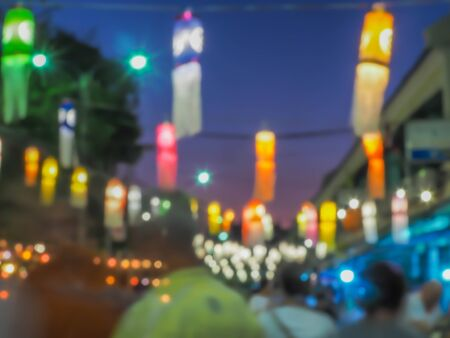 Abstract blurry people movement, multicolored colorful bokeh, traditional paper lamp. Festival in the park, night lights, art, creativity, glittering pattern, texture and background concept and idea. Imagens
