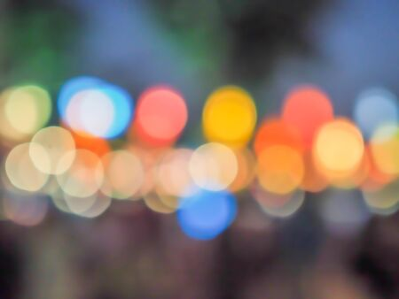 Abstract blurry and multicolored colorful bokeh on defocused garden background. Garden or outdoor night lights, art, creativity, glittering pattern and texture concept and idea. Imagens